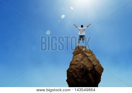 Man on top of mountain conceptual design of success freedom excitement motivation