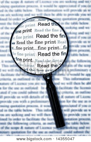 "Magnifying glass over document, highlighting the words ""read the fine print"".  Cyan toned image."