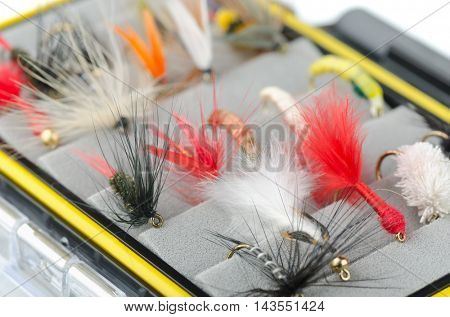 Close up of fly fishing flies in box