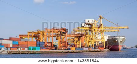 Panorama of Cargo industrial ship unloading goods at Terminal Port