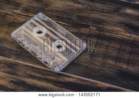 music on the old magnetic cartridge on a wooden table