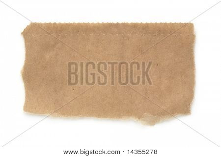 Torn piece of a brown paper bag, isolated on white with soft shadow.  Macro, with lots of paper textures and serrated top edge.