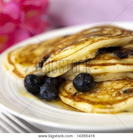 Blueberry buttermilk pancakes, with maple syrup.  A sweet way to start the day.