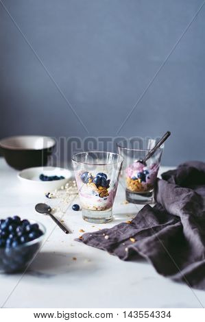 Parfait with muesli, blueberries and yogurt. Selective focus
