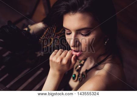 closeup shot of young brunette model posing in burlesque fitting room
