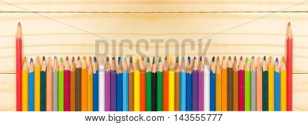 Panorama pencil standing out from the other colors. on wood background
