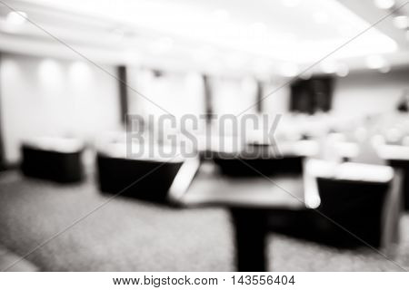 Blur Background, Podium At Seminar Event Room With Bokeh Light Background,business Concept,black And