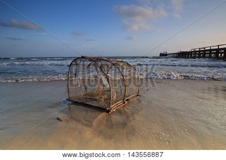 the old trap on low tide beach when sunset
