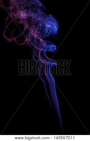 Abstract art. Color lilac smoke from the aromatic sticks on a black background. Background for Halloween. Texture fog. Design element. The concept of aromatherapy.