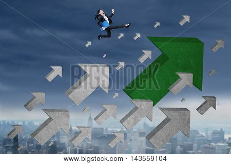 Photo of young businesswoman carrying document and runs above upward arrow at the sky