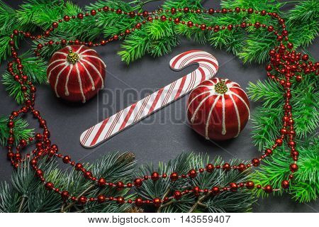 Christmas Decorations, Frame With Fir Branches, Two Red Balls And Beads On A Black Background
