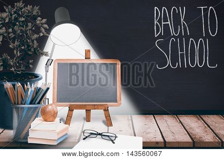 Back to school message against blackboard