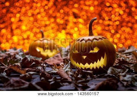 Pumpkin for Halloween, lamp pumpkin, antique wood, celebrating halloween, smiley on a pumpkin, autumn dry leaves, bright background, funny and angry