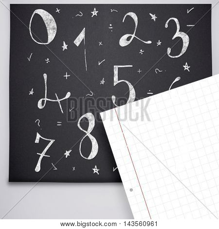 Drawn numbers against spiral notepad