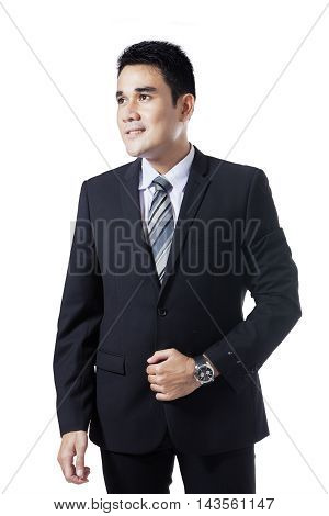 Portrait of confident male entrepreneur wearing formal suit and standing in the studio