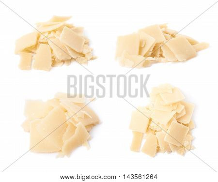 Pile of parmesan cheese flakes isolated over the white background, set of four different foreshortenings