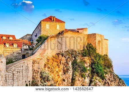 Dubrovnik Croatia. Sunset golden light over Old Town roofs and fortress walls of Ragusa (Duvrovnik).