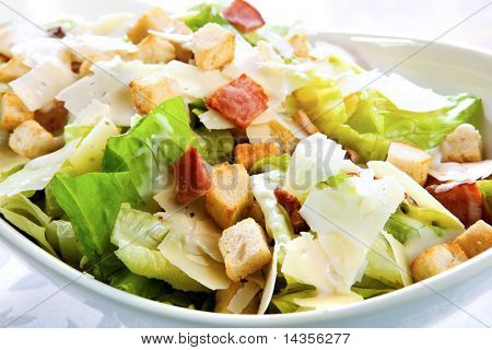 Caesar salad, with kos lettuce, bacon, croutons, parmesan, and creamy dressing.