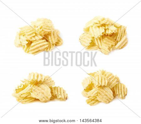 Big pile of potato chips crisps isolated over the white background, set of four different foreshortenings