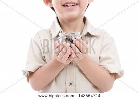 Cute Asian child saving money in glass bottlemoney saving concept