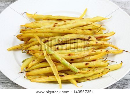Grilled yellow beans focused on grilled bean legume with bean seeds