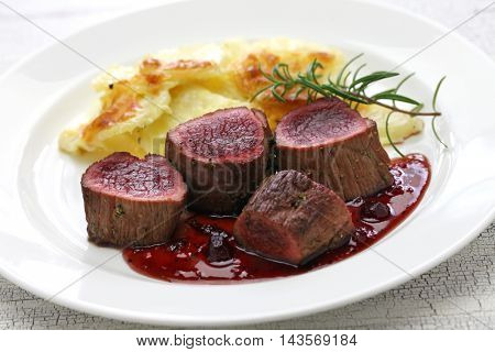 venison steak with creamy baked potato