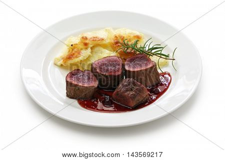 venison steak with creamy baked potato isolated on white background