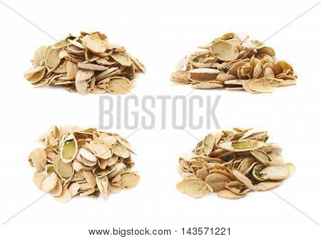 Pile of pumpkin seeds shells isolated over the white background, set of four different foreshortenings