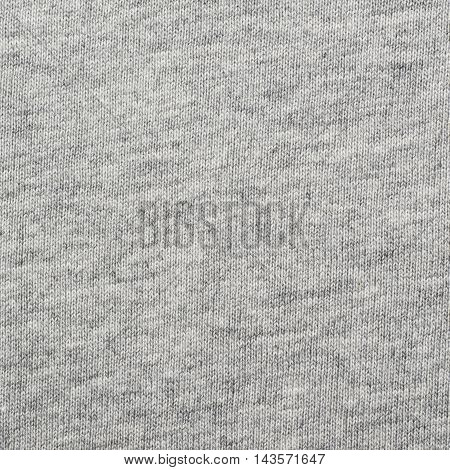 Fragment of a grey cloth fabric material texture as an abstract background composition