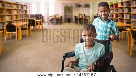 Boy pushing friend on wheelchair against view of library