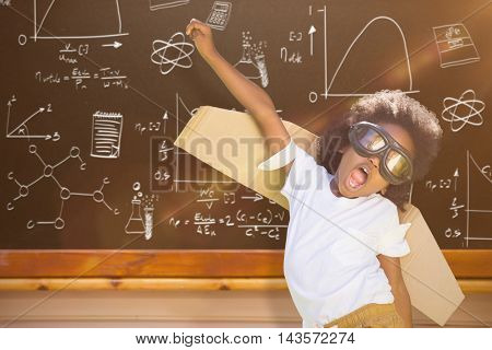 Boy playing as an aviator at park against blackboard