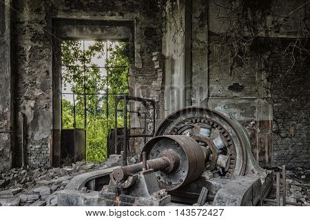 Dusty Machinery in abandoned factory ready for demolition