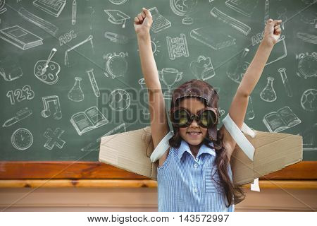 Young girl pretending to fly against blackboard
