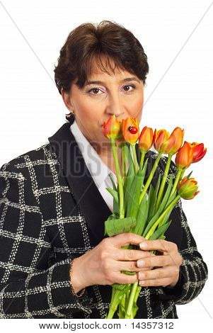 Mature Woman Holding Tulips In Front Of Face