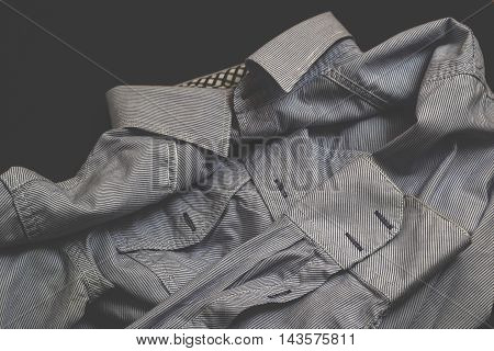 White, vintage men's shirt on black background
