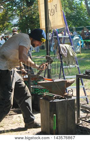Myrgorod, Ukraine - August 20, 2016: Blacksmith at work on the festival of blacksmiths
