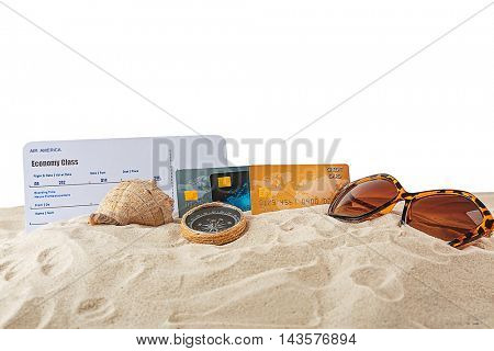 Credit cards and ticket on sand, white background