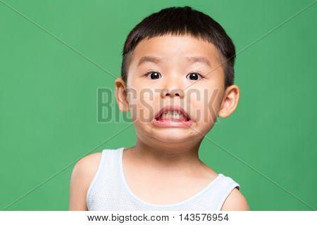 Little boy showing grimace