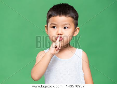 Little boy telling you to make silence
