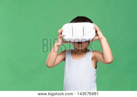Little boy watching though VR