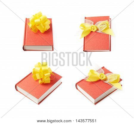Red gift book with the yellow decorational bow over it, composition isolated over the white background, set of four different foreshortenings