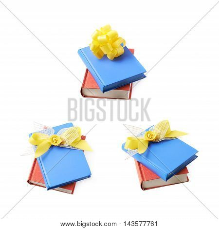 Red and blue book composition with the yellow decorational bow over it, isolated over the white background, set of three different foreshortenings