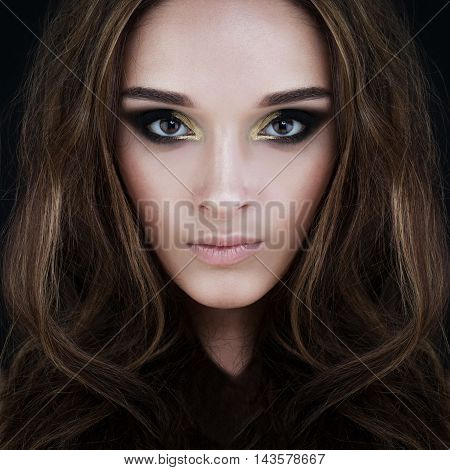Glamorous Brunette Beauty. Perfect Face with blue eyes