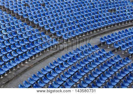 Arrays of blue seats on the stadium.