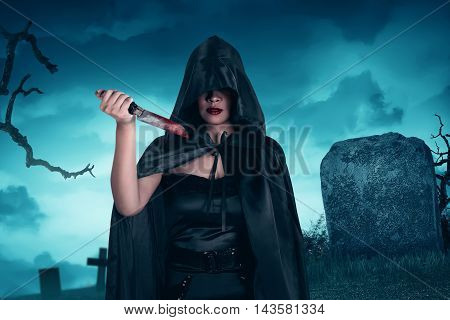 Asian Witch Woman Holding