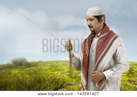 Young Asian Muslim Man Look Handsome.