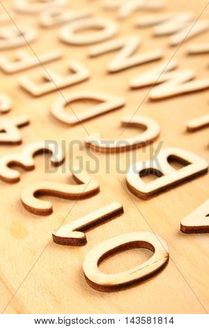 Wooden alphabet and numbers in order on the wooden background