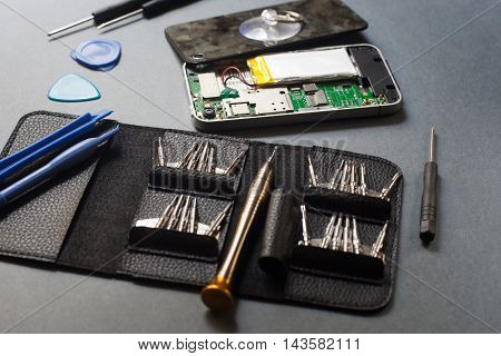 Tool for repair electronic devices. Set of special instruments for modern gadgets maintenance on gray background