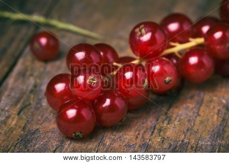 Detail Bunch Of Red Currants On A Old Wooden Table.