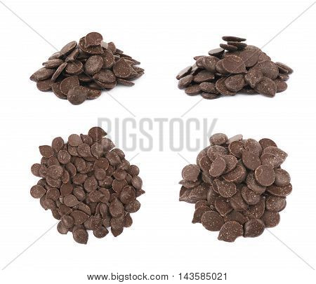 Pile of cooking chocolate teardrop shaped chips isolated over the white background, set of four different foreshortenings